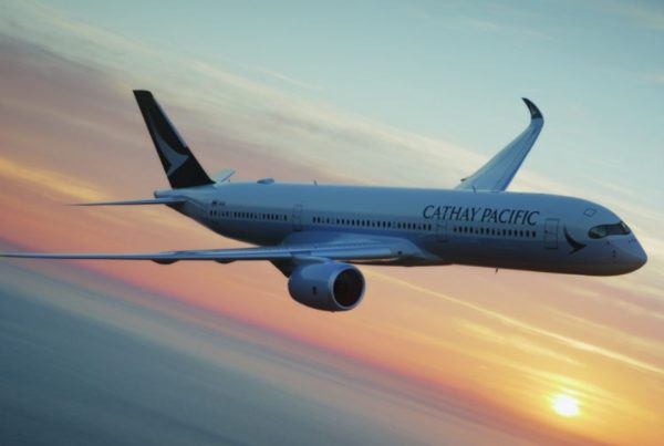 cathay pacific plane banking on horizon